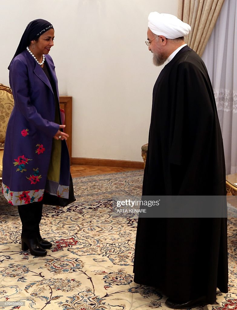 Iranian President <a gi-track='captionPersonalityLinkClicked' href=/galleries/search?phrase=Hassan+Rouhani+-+Politician&family=editorial&specificpeople=641593 ng-click='$event.stopPropagation()'>Hassan Rouhani</a> (R) welcomes Venezuelan Foreign Minister Delcy Rodriguez during their meeting in the Iranian capital Tehran on April 20, 2015.