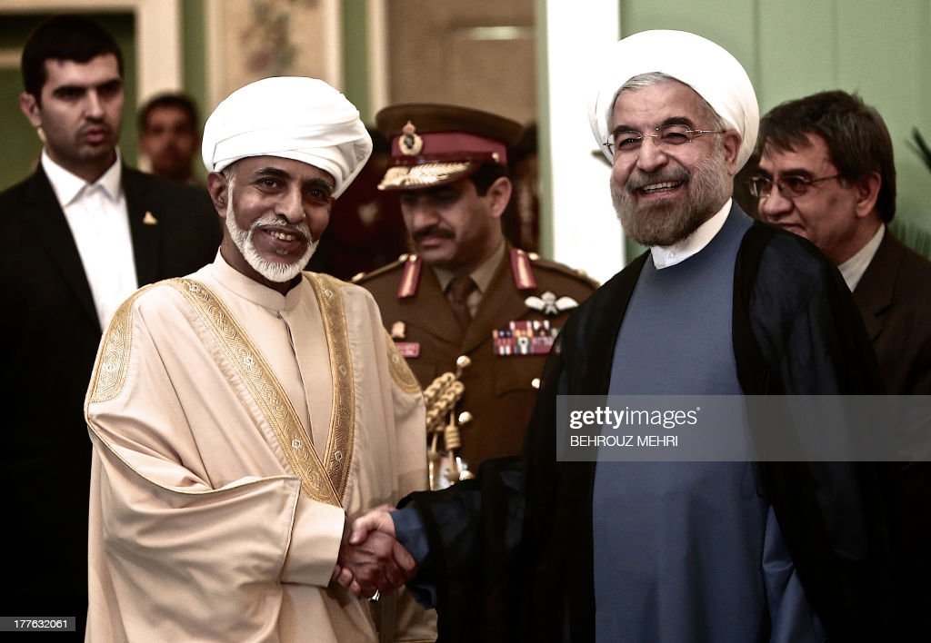 Iranian President Hassan Rowhani (R) poses for a picture with Oman's Sultan Qaboos bin Said (L) during the latter's welcoming ceremony at Tehran's Saadabad Palace on August 25, 2013. The Iranian authorities have announced that Sultan Qaboos of Oman, the only Gulf leader to maintain good relations with Tehran, arrived in Iran for a focus on economic issues and diplomacy visit. AFP PHOTO/BEHROUZ MEHRI