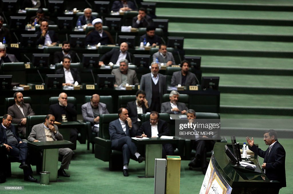 Iranian President Mahmoud Ahmadinejad addresses lawmakers on the county's economic situation during a session at the parliament in Tehran on January 16, 2013. Experts from the International Atomic Energy Agency (IAEA) arrived in Tehran to try resolve long-running differences with Iran over its controversial nuclear programme.