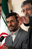 Iranian President Mahmoud Ahmadinejad and Parliament Speaker GhloamAli HaddadAdel during the President's brief response to a number of parliamentary...