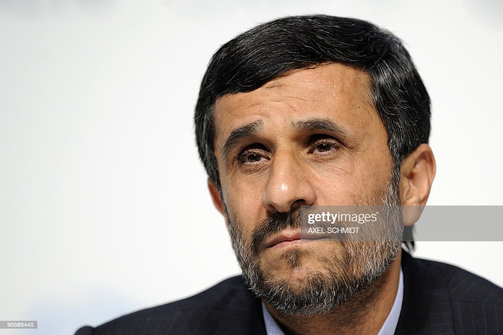Iranian President Mahmoud Ahmadinejad attends a press conference at the Bella center of Copenhagen on December 18, 2009 on the 12th day of COP15 UN Climate Change Conference. Ahmadinejad accused Barack Obama of following the footsteps of George W. Bush since entering the White House, saying he had missed a chance to make a clean break. AFP PHOTO DDP / AXEL SCHMIDT GERMANY OUT
