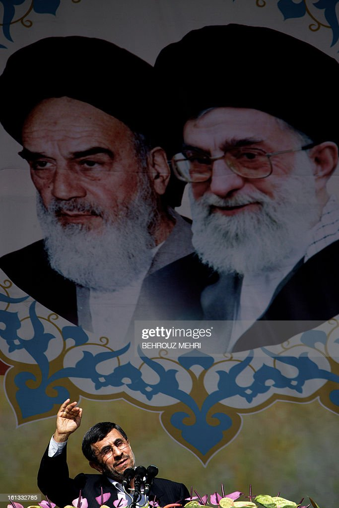 Iranian President Mahmoud Ahmadinejad delivers a speech as he stands under portraits of late founder of Islamic Republic, Ayatollah Ruhollah Khomeini (L) and supreme leader, Ayatollah Ali khamenei (R) during a rally in Tehran's Azadi Square (Freedom Square) to mark the 34th anniversary of the Islamic revolution on February 10, 2013. Hundreds of thousands of people marched in Tehran and other cities chanting 'Death to America' and 'Death to Israel' as Iran celebrated the anniversary of the ousting of the US-backed shah.