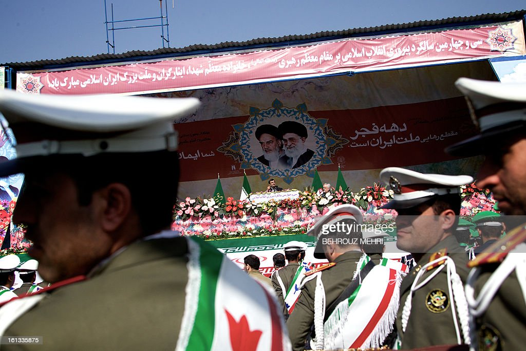 Iranian President Mahmoud Ahmadinejad (C) delivers a speech as he stands under portraits of late founder of Islamic Republic, Ayatollah Ruhollah Khomeini (L) and supreme leader, Ayatollah Ali khamenei (R) during a rally in Tehran's Azadi Square (Freedom Square) to mark the 34th anniversary of the Islamic revolution on February 10, 2013. Hundreds of thousands of people marched in Tehran and other cities chanting 'Death to America' and 'Death to Israel' as Iran celebrated the anniversary of the ousting of the US-backed shah.