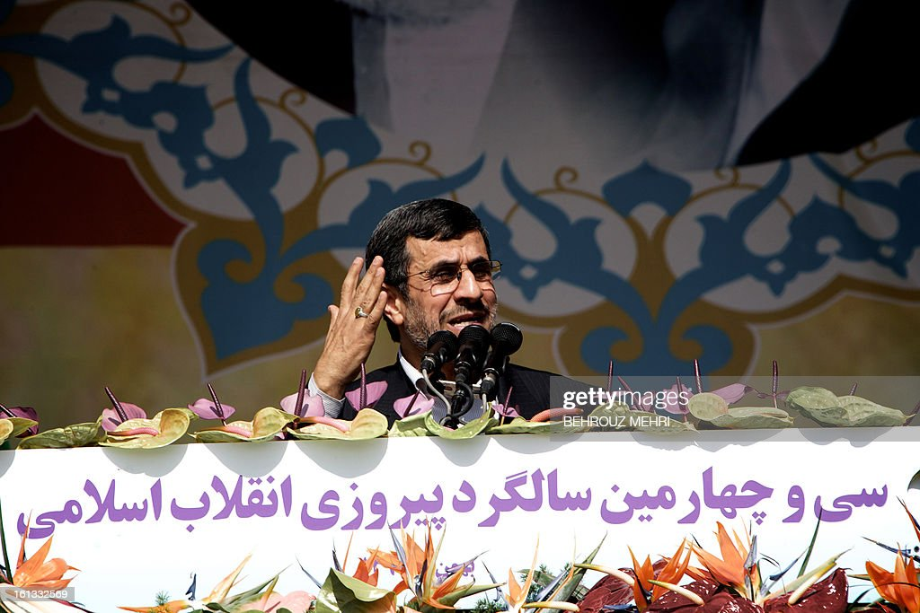 Iranian President Mahmoud Ahmadinejad delivers a speech during a rally in Tehran's Azadi Square (Freedom Square) to mark the 34th anniversary of the Islamic revolution on February 10, 2013. Hundreds of thousands of people marched in Tehran and other cities chanting 'Death to America' and 'Death to Israel' as Iran celebrated the anniversary of the ousting of the US-backed shah. AFP PHOTO/BEHROUZ MEHRI