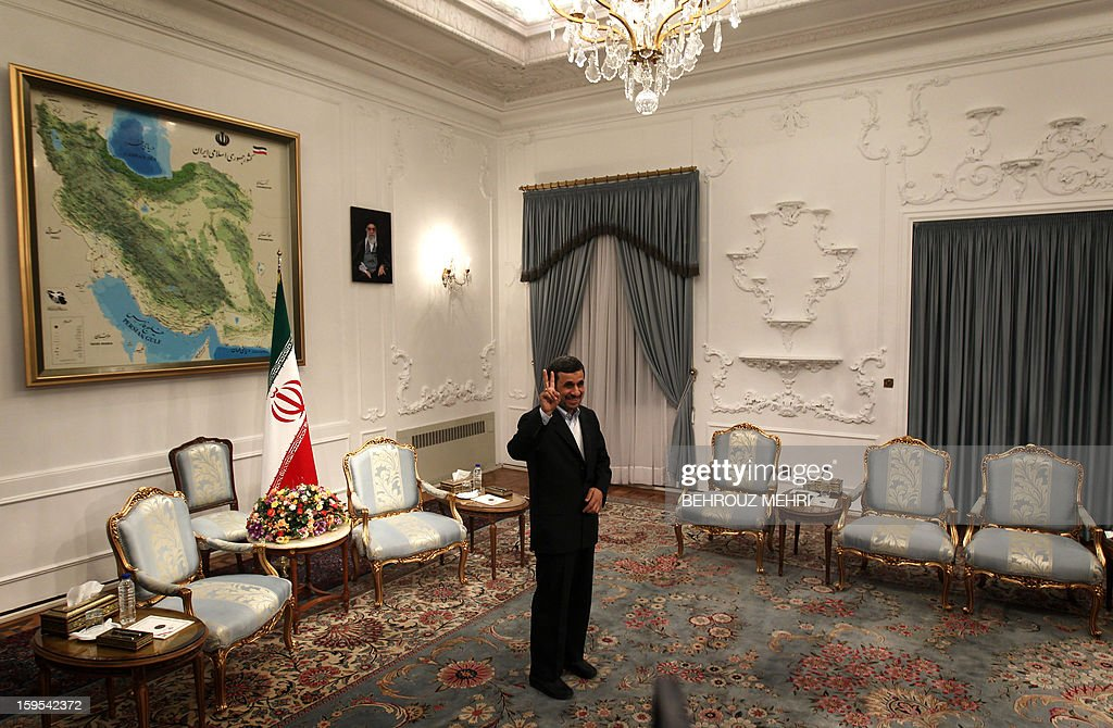 Iranian President Mahmoud Ahmadinejad flashes a victory sign ahead of his meeting with Syrian Prime Minister Wael al-Halaqi in Tehran on January 15, 2013. Fars news agency said the two sides will discuss 'expansion of bilateral relations and Syrian President Bashar al-Assad's three-step plan' for the political future, presented on January 6.
