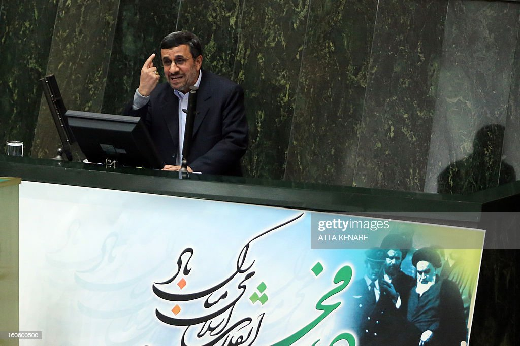 Iranian President Mahmoud Ahmadinejad gestures as he delivers a speech to the parliament in Tehran on February 3, 2013. Heated debates between Iran's government and parliament came out over the impeachment of labour and social welfare minister, Abdolreza Sheikholeslam, with heads of the two branches accusing each other of corruption and abuse of power.