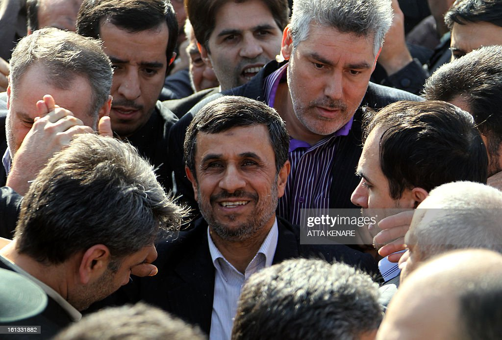 Iranian President Mahmoud Ahmadinejad (C) greets supporters during a rally in Tehran's Azadi Square (Freedom Square) to mark the 34th anniversary of the Islamic revolution on February 10, 2013. Hundreds of thousands of people marched in Tehran and other cities chanting 'Death to America' and 'Death to Israel' as Iran celebrated the anniversary of the ousting of the US-backed shah.