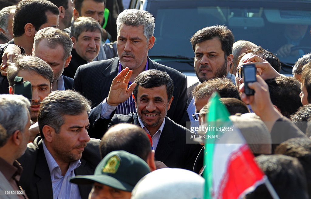 Iranian President Mahmoud Ahmadinejad (C) greets supporters prior to giving a speech lashing out at the West and Israel during a rally in Tehran's Azadi Square (Freedom Square) to mark the 34th anniversary of the Islamic revolution on February 10, 2013.