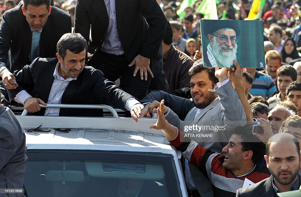 Iranian President Mahmoud Ahmadinejad (L) greets supporters prior to giving a speech, in which he lashed out at the West and Israel, during a rally in Tehran's Azadi Square (Freedom Square) to mark the 34th anniversary of the Islamic revolution on February 10, 2013.