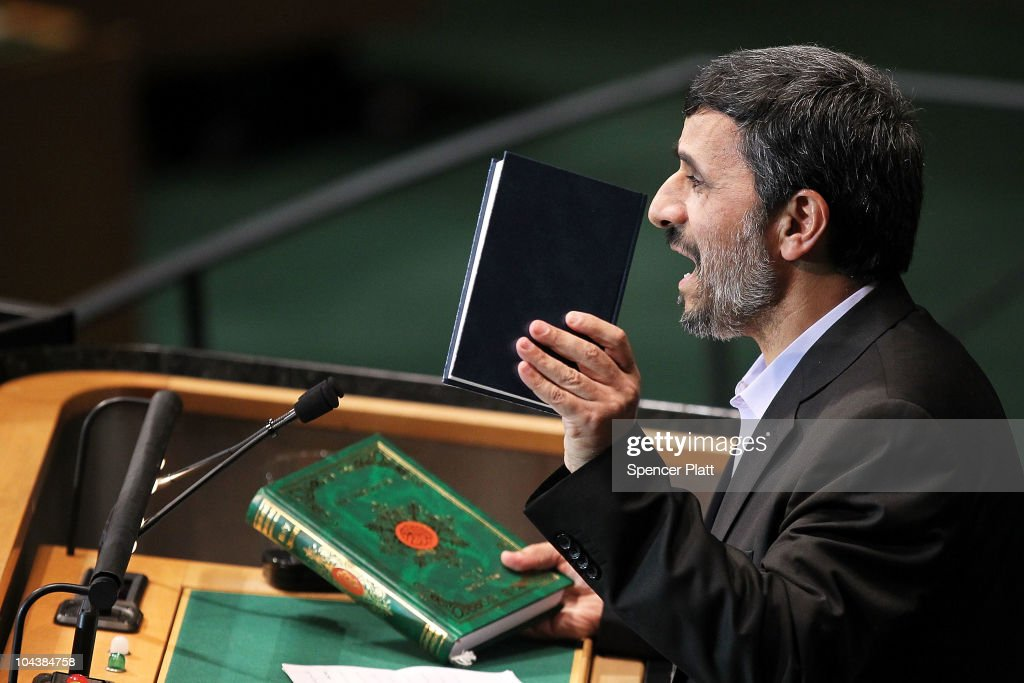 Iranian President Mahmoud Ahmadinejad holds up a Bible and a Koran while addressing world leaders during the General Assembly at the United Nations...