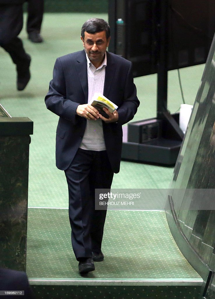Iranian President Mahmoud Ahmadinejad leaves the podium after addressing lawmakers on the county's economic situation at the parliament in Tehran on January 16, 2013. Experts from the International Atomic Energy Agency (IAEA) arrived in Tehran to try resolve long-running differences with Iran over its controversial nuclear programme.