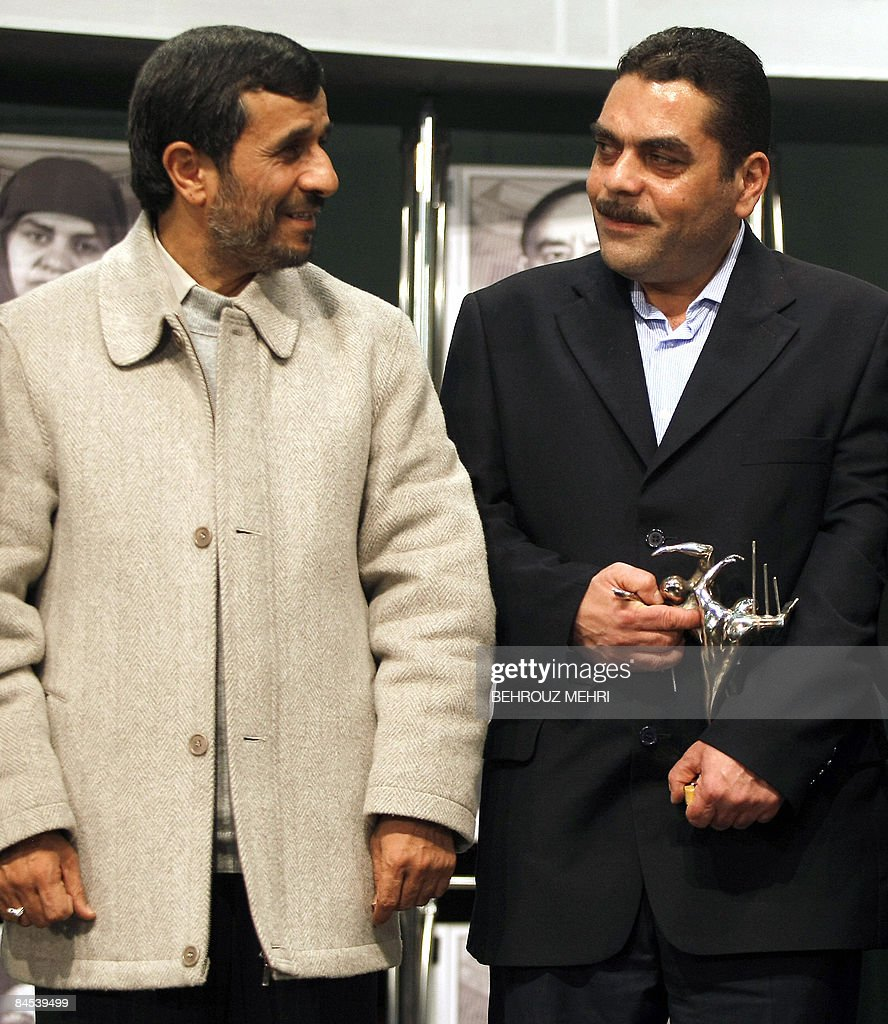Iranian President Mahmoud Ahmadinejad (L) poses for a picture with Lebanese militant and convicted murderer, Samir Kantar (R), during a ceremony in Tehran on January 29, 2009, to honour the political prisoners of the shah's regime before the Islamic revolution. Kantar, who was controversially freed by Israel in a prisoner swap last year, called for the destruction of Israel during a visit to Tehran where he was greeted by Ahmadinejad and honoured with the presentation of a statue of two prisoners trying to break through the bars of a jail cell. AFP PHOTO/BEHROUZ MEHRI