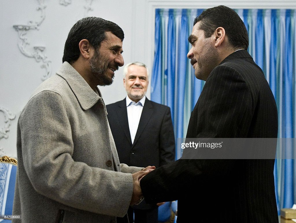 Iranian President Mahmoud Ahmadinejad (L) shakes hands with Lebanese militant and former prisoner in Israel Samir Kantar (R) during their meeting in Tehran on February 9, 2009. Kantar, who was controversially freed by Israel in a prisoner swap last year, called for the destruction of the Jewish state at the start of his visit to Tehran in January. Described as a monster in Israel where he was convicted of killing three people, including a policeman and a four-year-old girl in a notorious attack nearly three decades ago, Kantar is considered a hero by some in Lebanon.
