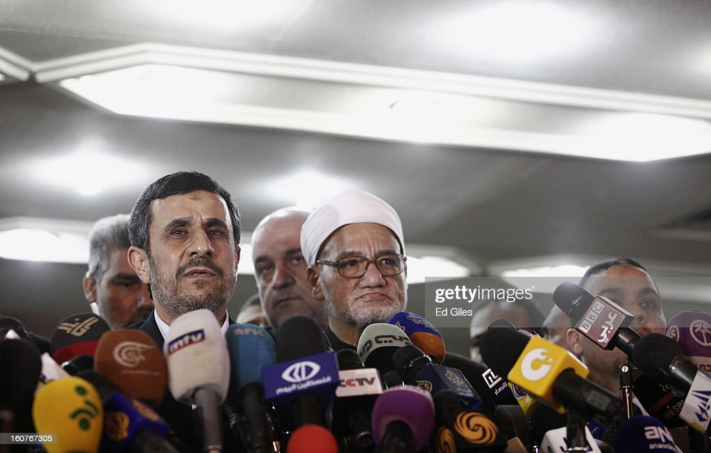 Iranian President Mahmoud Ahmadinejad speaks to the media alongside Sheikh Hassan alShafei of the Al Azhar mosque during a press conference at the Al...