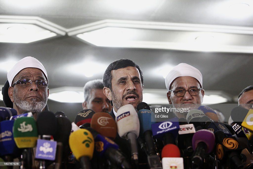 Iranian President Mahmoud Ahmadinejad speaks to the media flanked by two Sheikhs of the Al Azhar mosque during a press conference at the Al Ahzar...