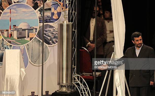 Iranian President Mahmoud Ahmadinejad unveils a sample of the third generation centrifuge for uranium enrichment during a ceremony to mark the...