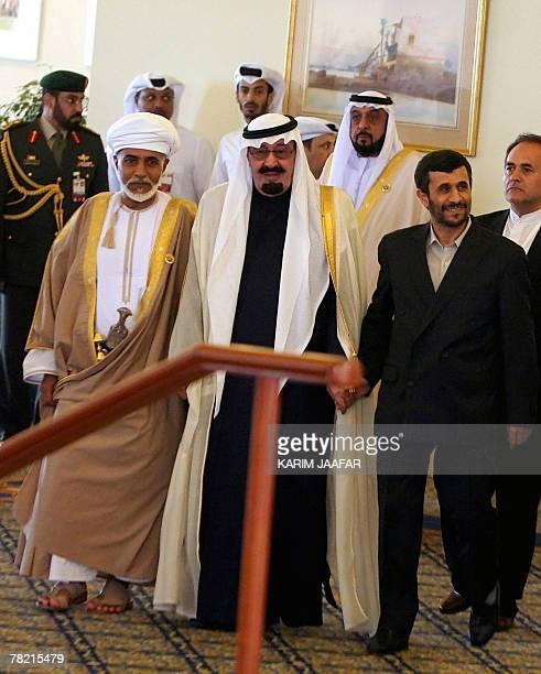 Iranian President Mahmoud Ahmadinejad walks handinhand with Saudi King Abdullah bin Abdul Aziz alSaud and Omani leader Sultan Qaboos bin Said as they...