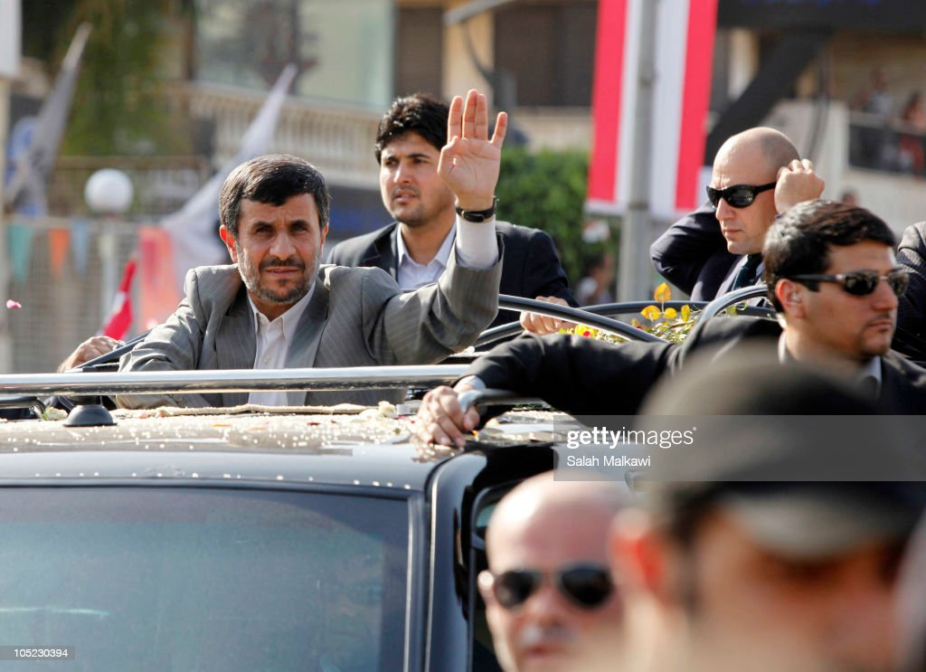 Iranian President <a gi-track='captionPersonalityLinkClicked' href=/galleries/search?phrase=Mahmoud+Ahmadinejad&family=editorial&specificpeople=221337 ng-click='$event.stopPropagation()'>Mahmoud Ahmadinejad</a> waves to the crowd in southern suberb of Beirut upon his arrival on October 13, 2010 in Lebanon. The controversial visit is seen as a boost for key ally Hezbollah. According to reports Mr Ahmadinejad may visit the border with Israel - the site of recent deadly clashes between Israeli and Lebanese forces.