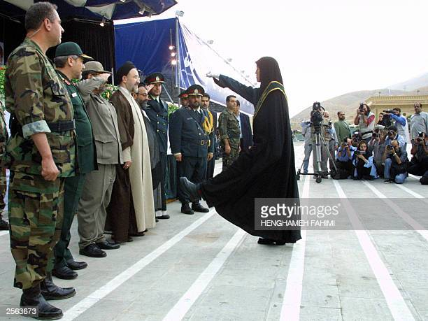 Iranian president Mohammad Khatami attends a gradation ceremony at Tehran's police academy 04 October 2003 Iran bestowed diplomas upon 215 women the...
