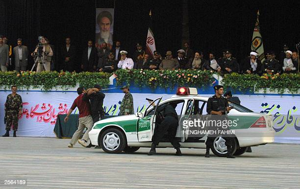 Iranian President Mohammad Khatami attends a gradation ceremony at Tehran's police academy 04 October 2003 during which police graduates conducted an...