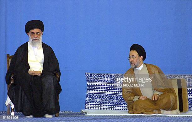 Iranian President Mohammad Khatami listens to Iran's supreme leader Ayatollah Ali Khamenei at the Imam Khomeini mosque in Tehran 02 August 2001...