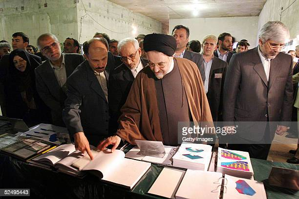 Iranian President Mohammad Khatami looks at documents during a visit to a nuclear power plant March 30 2005 in Natanz Iran Khatami was accompanied by...