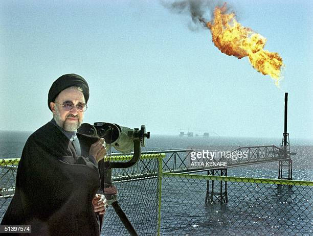 Iranian President Mohammad Khatami surveys the offshore oil rig at Forouzan 100km south of Khark Island in the Persian Gulf 13 March 2000 where...