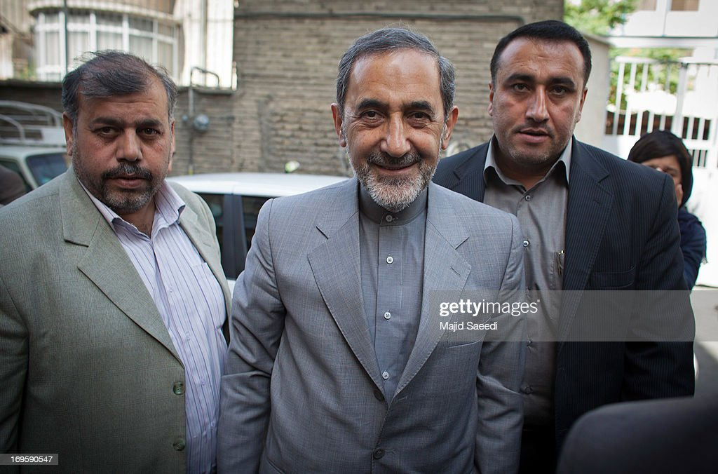 Iranian presidential candidate, <a gi-track='captionPersonalityLinkClicked' href=/galleries/search?phrase=Ali+Akbar+Velayati&family=editorial&specificpeople=1114721 ng-click='$event.stopPropagation()'>Ali Akbar Velayati</a>, (C) a conservative former Foreign Minister, arrives for a press conference on May 28, 2013 in Tehran, Iran. Velayati is a senior advisor to the supreme leader Ayatollah Ali Khamenei and is running in next month's presidential elections scheduled for June 14. Velayati says he will tackle Iran's high inflation and unemployment if he is elected.
