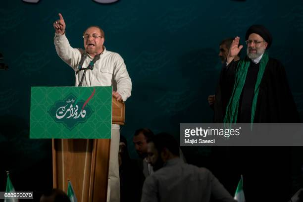 Iranian presidential candidate cleric Ebrahim Raisi right with Tehran Mayor Mohammad Bagher Qalibaf as they wave to their supporters upon arrival at...