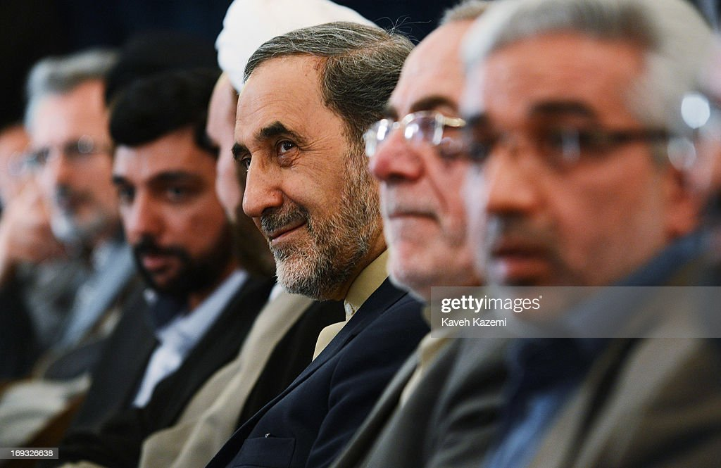 Iranian presidential candidate Dr. <a gi-track='captionPersonalityLinkClicked' href=/galleries/search?phrase=Ali+Akbar+Velayati&family=editorial&specificpeople=1114721 ng-click='$event.stopPropagation()'>Ali Akbar Velayati</a>, the former foreign minister of Iran and a special adviser to the supreme Iranian leader Ayatollah Ali Khamenei, (3rd R)) sits with university dignitaries before speaking about his presidential agenda at Tehran University on May 23, 2013 in Tehran, Iran. Velayati is one eight candidates approved to run in the June 14, presidential election to succeed President Mahmoud Ahmadinejad.