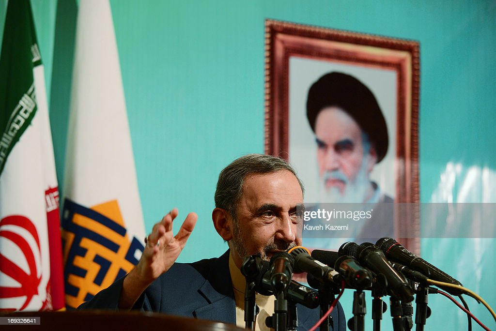 Iranian presidential candidate Dr. <a gi-track='captionPersonalityLinkClicked' href=/galleries/search?phrase=Ali+Akbar+Velayati&family=editorial&specificpeople=1114721 ng-click='$event.stopPropagation()'>Ali Akbar Velayati</a>, the former foreign minister of Iran and a special adviser to the supreme Iranian leader Ayatollah Ali Khamenei, speaks under a picture of Khamenei about his presidential agenda at Tehran University on May 23, 2013 in Tehran, Iran. Velayati is one eight candidates approved to run in the June 14, presidential election to succeed President Mahmoud Ahmadinejad.
