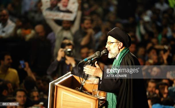 Iranian presidential candidate Ebrahim Raisi addresses his supporters during a campaign rally at Imam Khomeini Mosque in the capital Tehran on May 16...