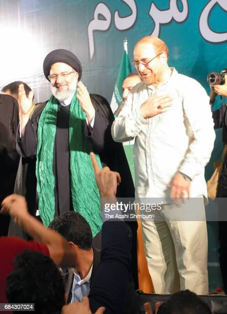 Iranian presidential candidate Ebrahim Raisi and former presidential candidate and mayor of Tehran Mohammad Bagher Ghalibaf greet supporters during a...