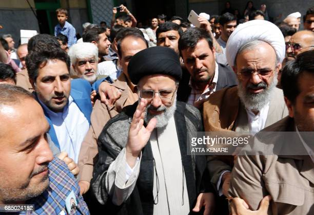 CORRECTION Iranian presidential candidate Ebrahim Raisi arrives to cast his ballot for the presidential elections at a polling station in southern...