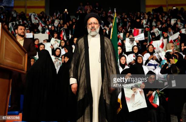 Iranian presidential candidate Ebrahim Raisi attends a campaign rally in the capital Tehran on April 29 2017 / AFP PHOTO / ATTA KENARE