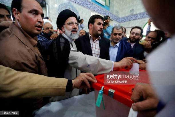 Iranian presidential candidate Ebrahim Raisi casts his ballot for the presidential elections at a polling station in southern Tehran on May 19 2017 /...