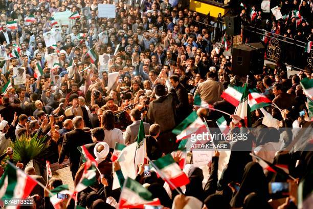 Iranian presidential candidate Ebrahim Raisi greets his supporters during a campaign rally in the capital Tehran on April 29 2017 / AFP PHOTO / ATTA...
