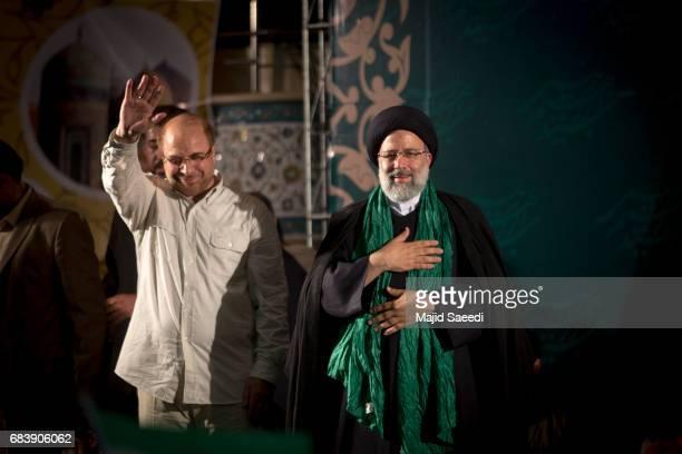 Iranian presidential candidate Ebrahim Raisi holds hands with former presidential candidate and mayor of Tehran Mohammad Bagher Ghalibaf as he greets...