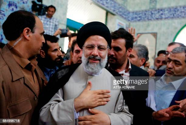 Iranian presidential candidate Ebrahim Raisi leaves after casting his ballot for the presidential elections at a polling station in southern Tehran...