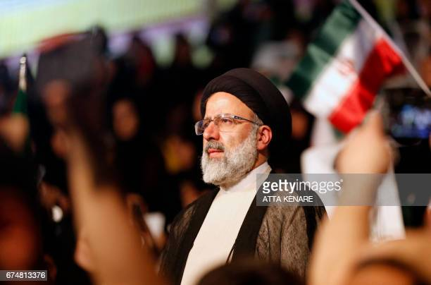 Iranian presidential candidate Ebrahim Raisi looks on during a campaign rally in the capital Tehran on April 29 2017 / AFP PHOTO / ATTA KENARE