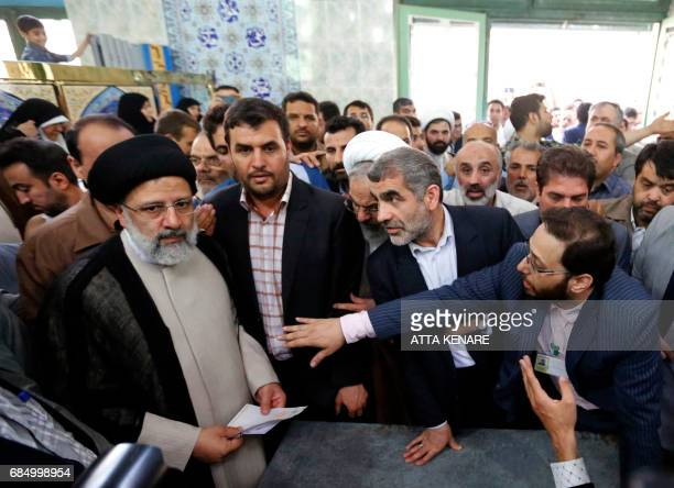 Iranian presidential candidate Ebrahim Raisi prepares to cast his ballot for the presidential elections at a polling station in southern Tehran on...