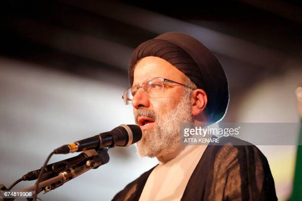 Iranian presidential candidate Ebrahim Raisi speaks during a campaign rally in the capital Tehran on April 29 2017 / AFP PHOTO / ATTA KENARE