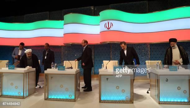 Iranian presidential candidates Hassan Rouhani Mohammad Baqer Qalibaf Eshaq Jahangiri and Ebrahim Raisi attend a live debate on state TV in Tehran on...
