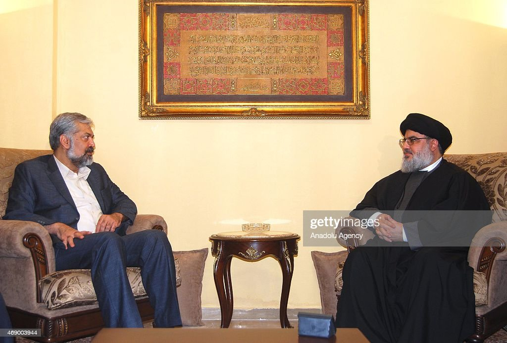 Iranian President's special envoy and deputy foreign minister Morteza Sarmadi (L) meets with Hezbollah leader Hasan Nasrallah (R) in Beirut, Lebanon on April 9, 2015.