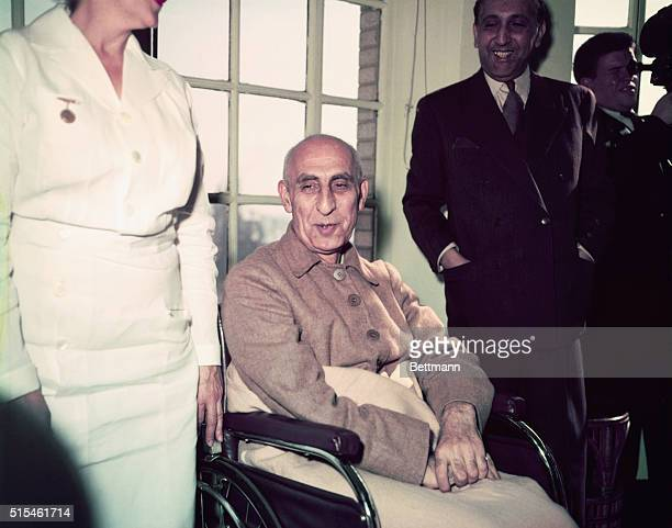 Iranian Prime Minister Mohammed Mossadegh is pictured sitting in a wheelchair in the solarium of the New York hospital which is his present...