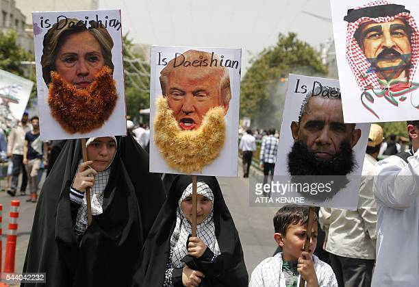 Iranian protesters hold portraits of US Democrat presidential candidate Hillary Clinton US Republican presidential candidate Donald Trump US...