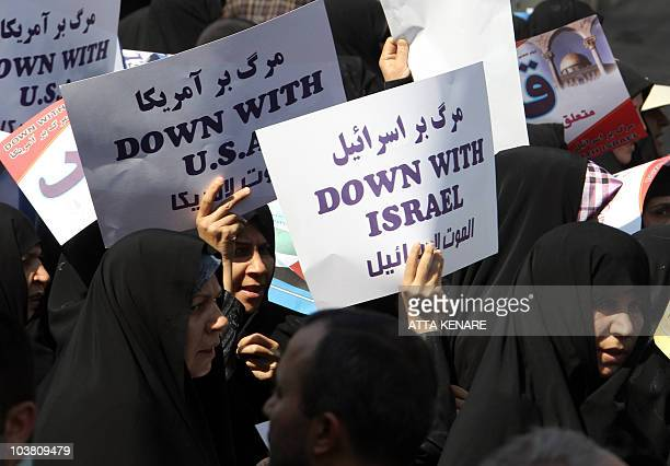 Iranian protesters hold up an antiIsrael and antiUS placards during the Jerusalem Day march in Tehran as the Islamic republic marked on September 3...