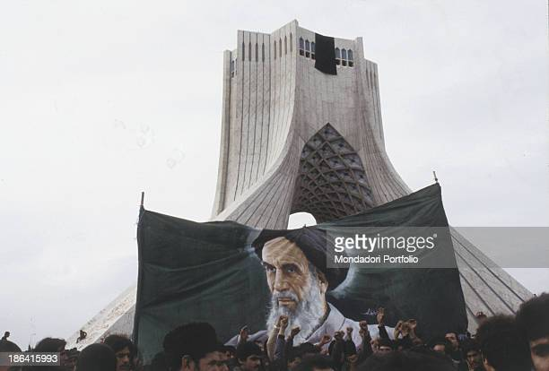 Iranian protesters in front of the Azadi Tower during the Iranian Revolution The population protests against the repressive regime of the Shah...