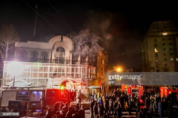 TOPSHOT Iranian protesters set fire to the Saudi Embassy in Tehran during a demonstration against the execution of prominent Shiite Muslim cleric...