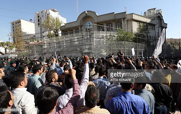 Iranian protesters shout slogans during a demonstration against Saudi Arabia outside its embassy in Tehran on September 27 four days after some...